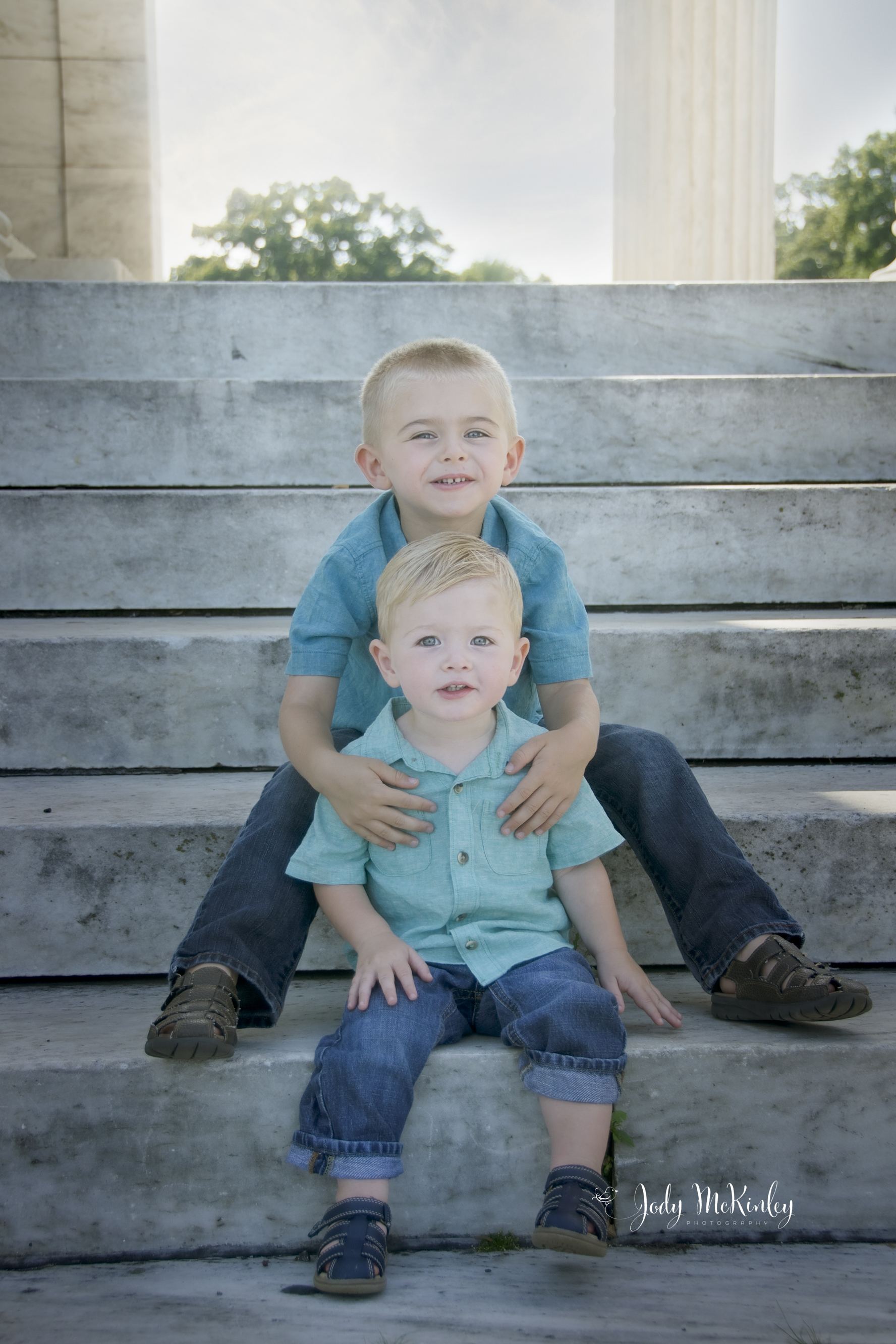 photo of two young brothers sitting on steps