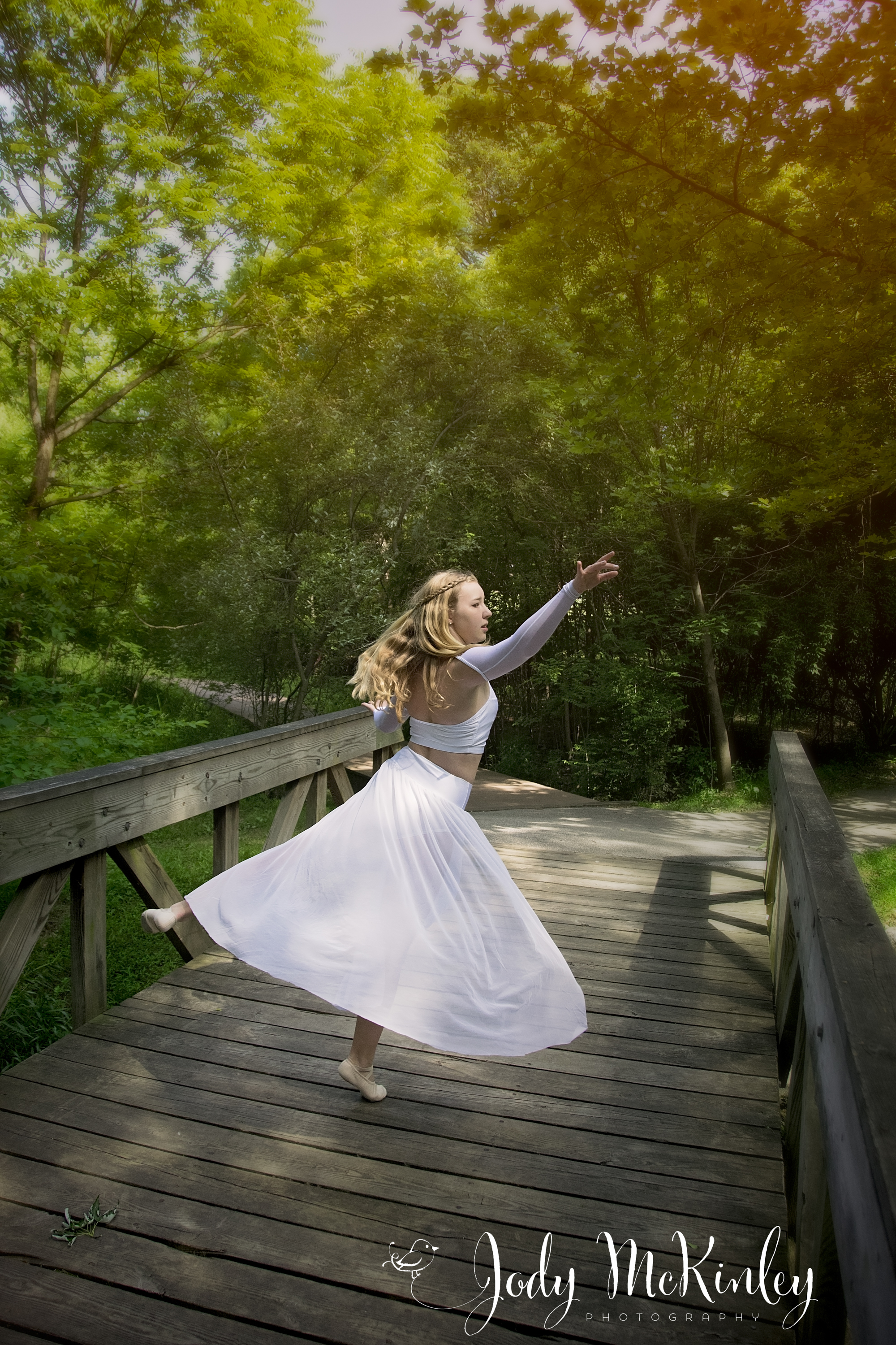 photo of young lady in graceful dance pose